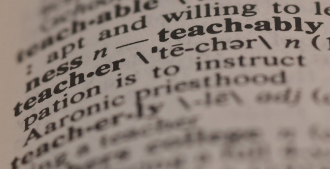 """unfocused picture of the term """"teacher"""" in a print dictionary"""